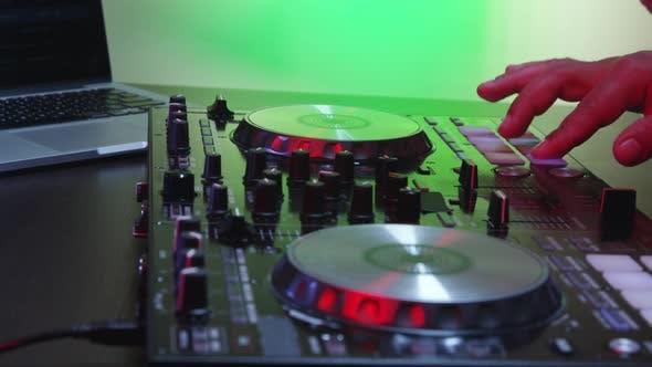 Thumbnail for DJ Using His Mixer Table 13