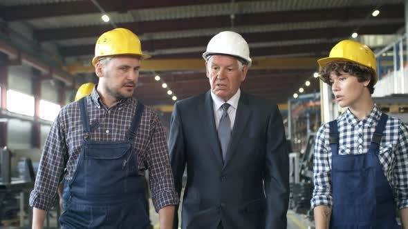 Thumbnail for Executive and Engineers Walking along Factory