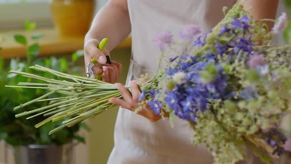 Thumbnail for Florist cutting off stems with shears