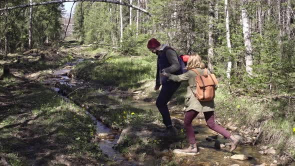 Thumbnail for Young Couple Stepping over Little Brook