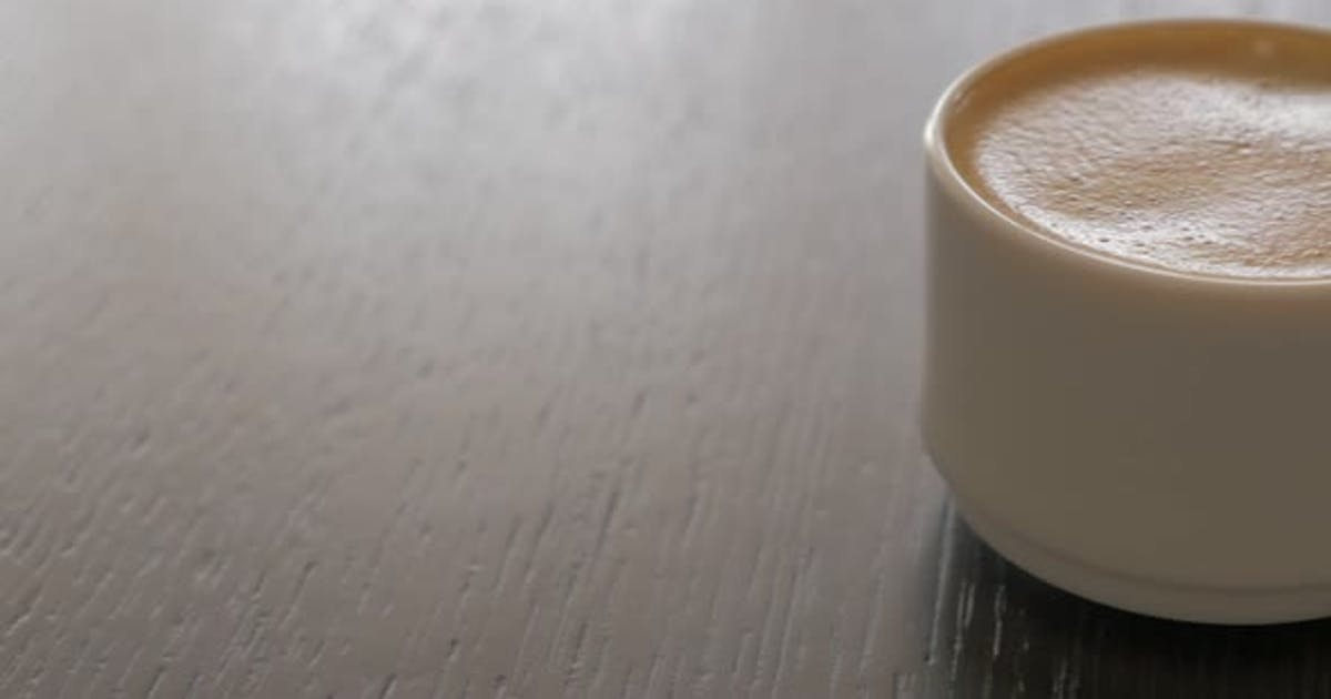 Espresso coffee cup on table panning 4K 2160p UHD video - Delicious coffee cream in the cup 4K 3840X