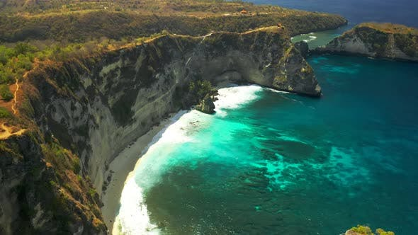 Thumbnail for Ocean Waves, Cliffs and a Tropical White Sand Beach in Nusa Penida Island, Bali in Indonesia. Aerial