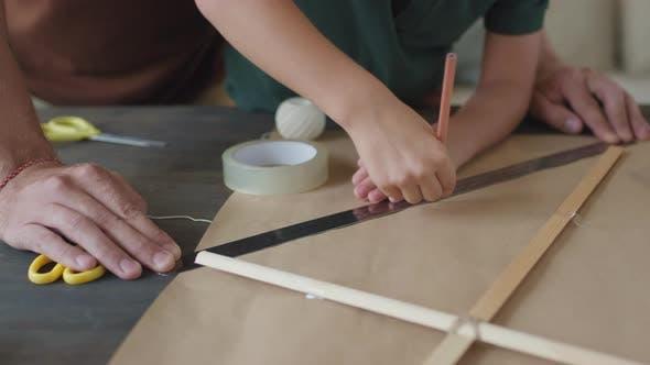 Thumbnail for Boy Drawing Outline For Handmade Kite