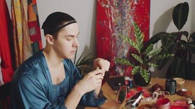 Transgender Man Applying Mascara