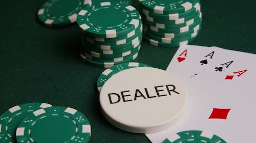 Rotating shot of poker cards and poker chips on a green felt surface - POKER 004