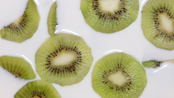 Milk fills a kiwi slices
