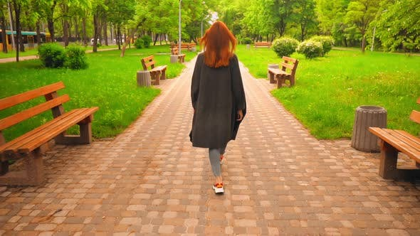 Thumbnail for Unrecognizable Ginger Female Walks and Have Fun on the Street Lifestyle in Spring City