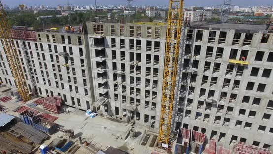 Thumbnail for Unfinished Apartment Complex with Builders on the Top, Aerial
