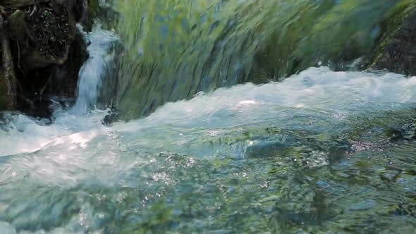 Thumbnail for The Mountain River Narrows Into a Small Waterfall