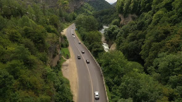Thumbnail for Aerial Drone Shot of Cars Moving Along Mountain River. Beautiful View of Mountain River Belaya on