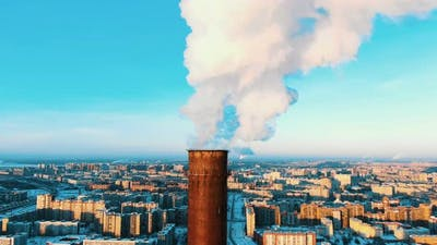 Aerial View of a Smoking Pipe of a Thermal Power Plant at Sunset