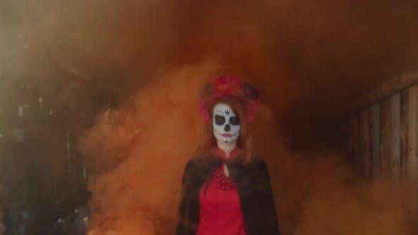 Thumbnail for Santa Muerte Appearing From Orange Smoke Indoors