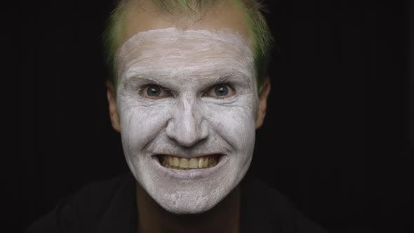 Thumbnail for Clown Halloween Man Portrait, Close-up of an Evil Clowns Face, White Face Makeup