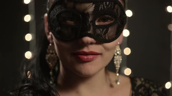 Woman in a Venetian Mask
