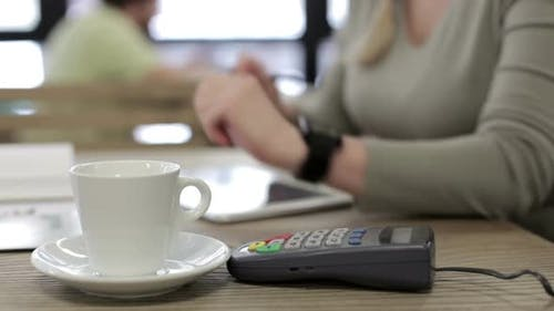 Pay using NFC technology using smart watches.