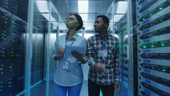 Thumbnail for Ethnic IT Specialists with Tablet in Server Room
