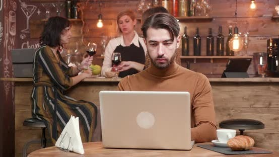 Cover Image for Young Business Man Finishing His Work, Closing His Laptop and Leaving in a Hurry