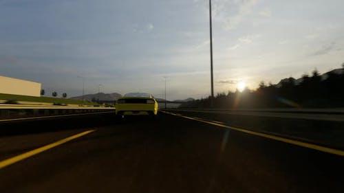 Yellow Luxury Sports Car Speeding On Highway