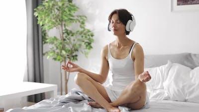 Woman in Headphones Relaxing Morning