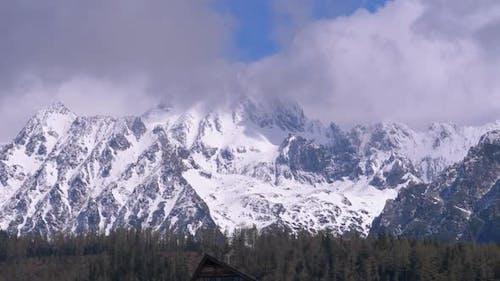 Snowy Mountain Peak in the Clouds, Strbske Pleso, Slovakia
