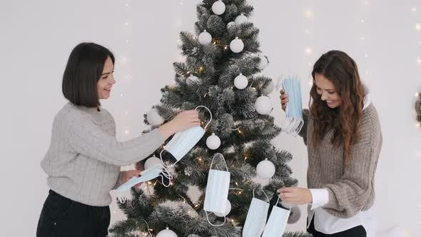 Thumbnail for Coronavirus Face Masks Being Hanged By Women on Christmas Tree