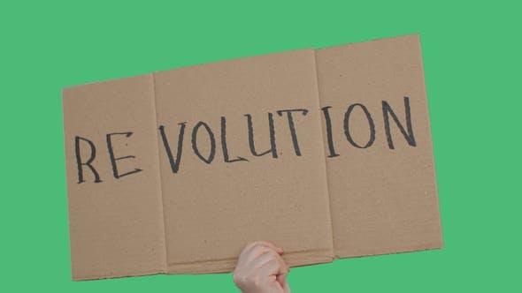Protester Holding Revolution Sign During Political Demonstration or Strike