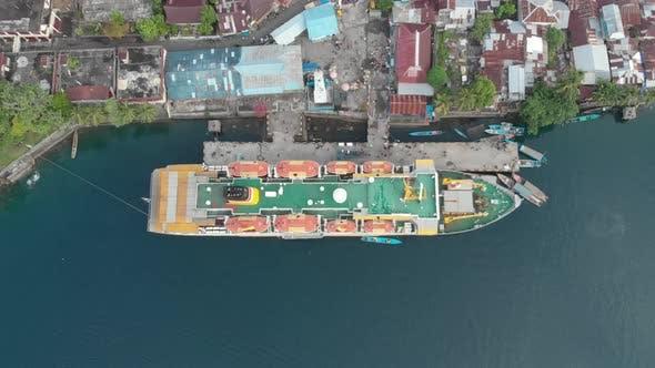 Aerial: flying over passenger ship Pelni in Bandaneira harbor Indonesia