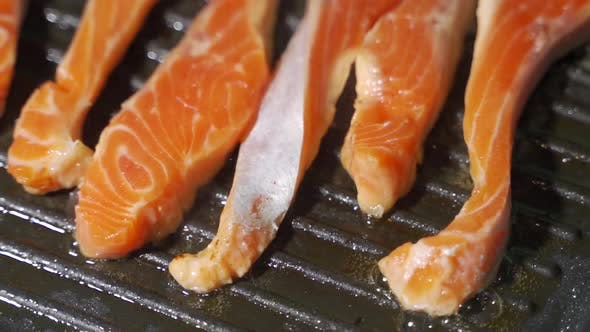 Thumbnail for Pan-fried Salmon, Trout. Slices of Red Fish Fried in a Pan.