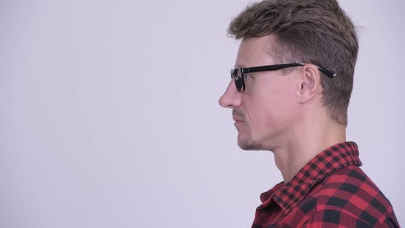 Thumbnail for Closeup Profile View of Handsome Bearded Hipster Man Thinking