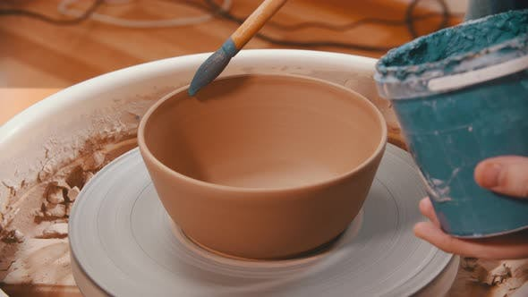 Thumbnail for Pottery - Man Is Painting with a Brush the Clay Bowl Inside Blue