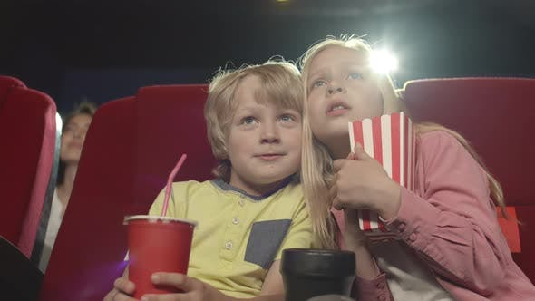 Thumbnail for Two Kids Watching Horror in Cinema