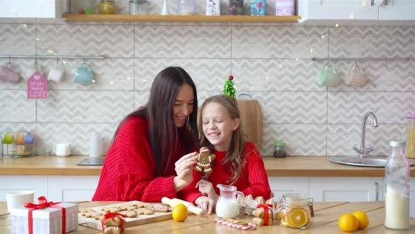 Happy Family Mother and Daughter Bake Cookies for Christmas