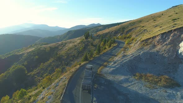 Thumbnail for Aerial View Of A Timber Truck Driving A Mountain Way