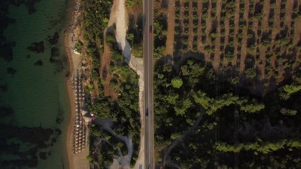 Thumbnail for Aerial View of Sea, Beach and Waterfront Road with Car Traffic, Greece