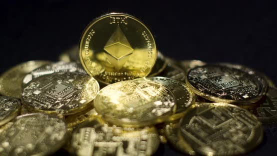 Thumbnail for Physical Cryptocurrency Golden Coins On Black Background