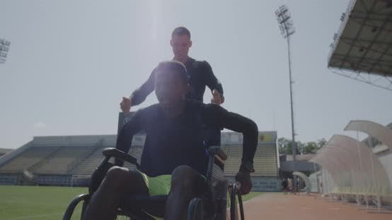 Thumbnail for Trainer Encouraging Disabled Athlete