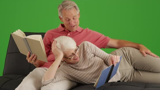 Thumbnail for Happy senior couple reading books on their leisure time on green screen