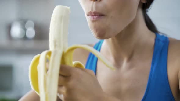 Thumbnail for Sports Woman with Pleasure Eating Sweet Banana, Hungry After Active Workout