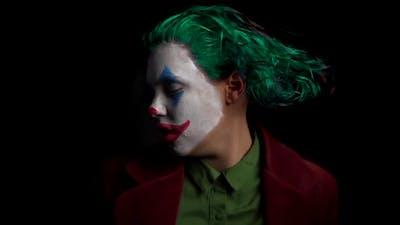 Clown Make-Up Joker With Green Hair For Halloween. Crazy woman dancing