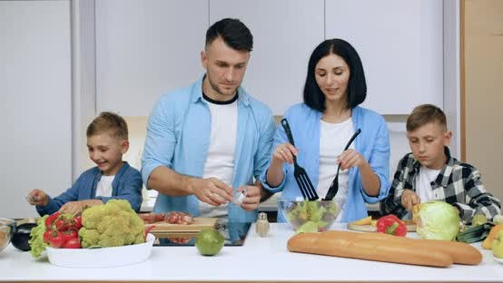 Thumbnail for Young Parents and Their Children which Helping Each Other to Prepare Family Dinner
