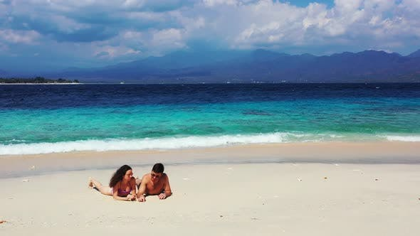 Cover Image for Romantic couple married on vacation enjoy luxury on beach on clean white sand background 4K