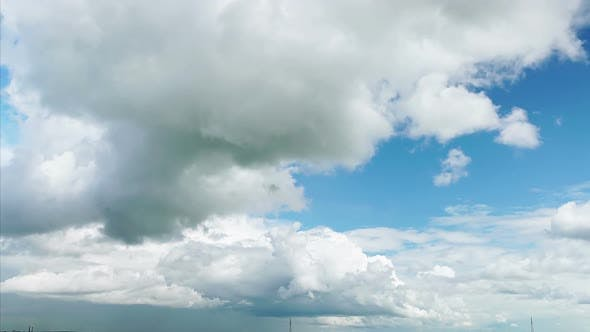 Time-Lapse: Oncoming White Cumulus Clouds