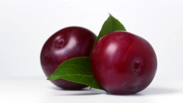Thumbnail for Plums rotating on white background
