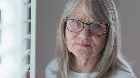 Thumbnail for Close up portrait of sad looking senior Caucasian woman in glasses