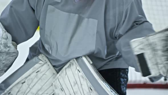 Thumbnail for Unrecognizable Goalie Blocking Puck with Glove
