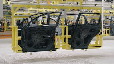 Automobile Plant Modern Production of Cars Transportation of Ready Car Doors on the Production Line