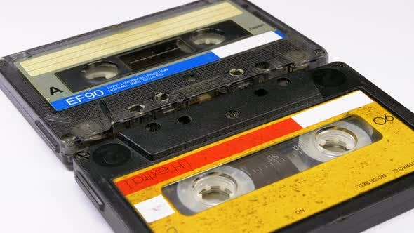 Two Vintage Audio Cassette Rotates on White Background