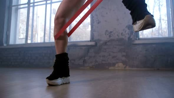 Thumbnail for Female Legs Tied with Elastic Band During Workout