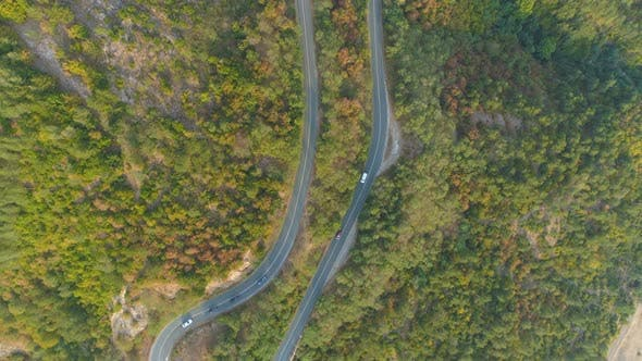 Thumbnail for Top View of Curvi Mountain Road with Many Cars Driving. People on Road Trip Traveling in Sunny