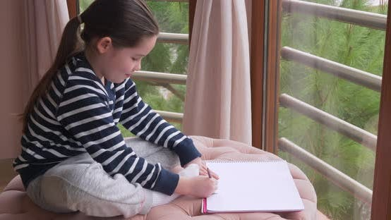 Thumbnail for A Little Girl Drawing with Pencils at Home